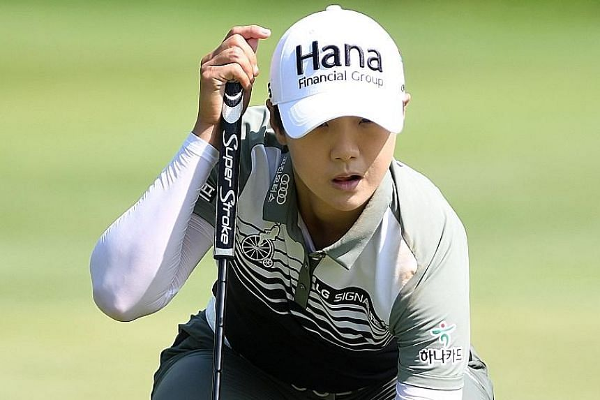 South Korean Park Sung-hyun lining up a putt on the eighth green during Thursday's first round of the Women's PGA Championship at Kemper Lakes Golf Club. She shot a six-under 66 for a one-shot lead.