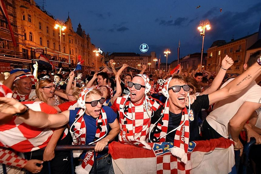 Croatian fans, wearing the national caps of their powerhouse water polo team, watching a giant screen in Zagreb's main square when their footballers took on Argentina on June 21.