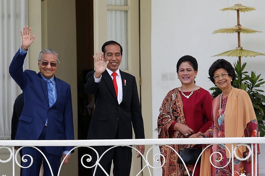 Tun Dr Mahathir and Mr Joko planting a tree in the compound of the presidential palace yesterday before holding talks.