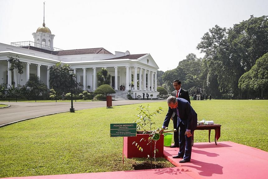 Malaysian Prime Minister Mahathir Mohamad (left) and his wife, Tun Dr Siti Hasmah Mohamad Ali (far right), with Indonesian President Joko Widodo and First Lady Iriana at the presidential palace in Bogor, south of Jakarta, yesterday. The Malaysian lea
