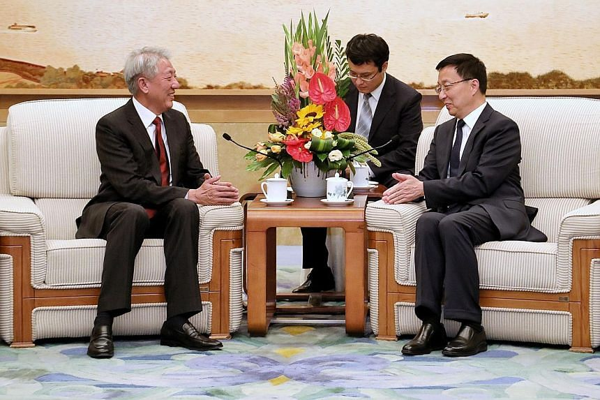 Deputy Prime Minister Teo Chee Hean meets his new Joint Council for Bilateral Cooperation counterpart, Chinese Vice-Premier Han Zheng, at the Great Hall of the People.