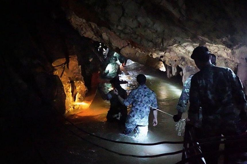 The desperate, round-the-clock search for the team has been beset by torrential downpours that submerged tunnels near the entrance of the Tham Luang cave, blocking divers from going on.