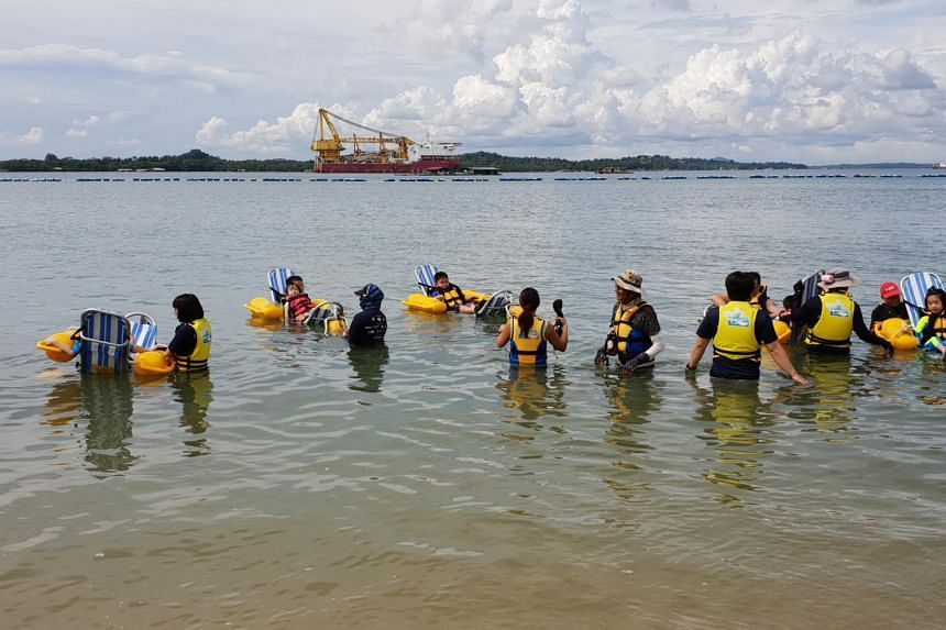 About 30 persons with disabilities got a taste of the sea at Pasir Ris Park on June 30, 2018, as they went on the first floating beach wheelchairs in Singapore.