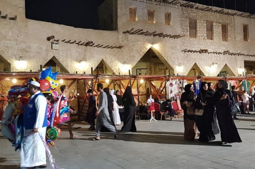 During the Ramadan fasting month, the shopping malls and traditional markets such as Souq Waqif (above) become abuzz with activity during the night.