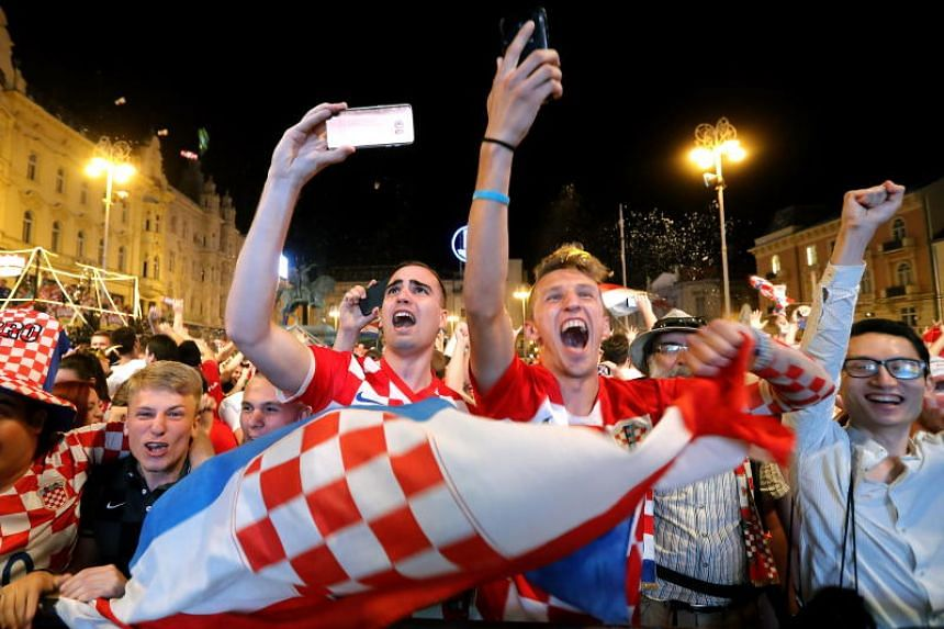 Croatian national soccer team fans celebrate winning the Fifa World Cup 2018 group D preliminary round soccer match between Croatia and Nigeria in downtown Zagreb, Croatia, on June 16, 2018.