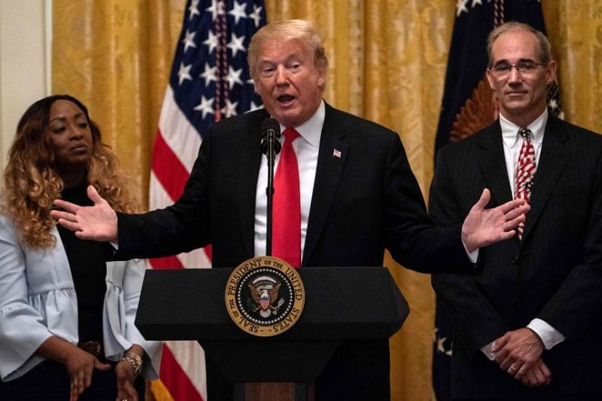 US President Donald Trump speaks about taxes on the six-month anniversary of his tax cuts in the East Room at the White House in Washington, DC, on June 29, 2018.