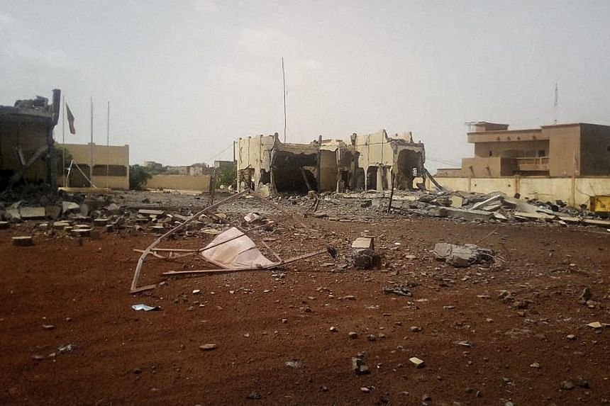 Debris scattered in front of the Malian headquarters of an international anti-terror task force, G5 Sahel, following an attack by a suicide bomber, on June 29, 2018.