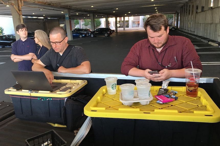Capital Gazette reporter Chase Cook (right) and photographer Joshua McKerrow (left) working on the next day's newspaper while awaiting news from their colleagues in Annapolis, Maryland, on June 28, 2018.