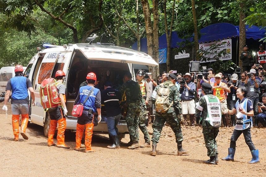 Thai rescue workers practice medical drills on a dirt road leading to the Tham Luang cave at the Khun Nam Nang Non Forest Park in Chiang Rai province on June 30, 2018.