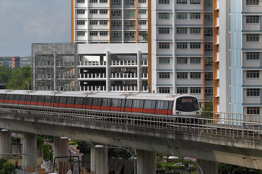 An MRT train approaching Pasir Ris MRT station, where extended railway tracks will allow a new turnback for trains to switch between the two opposite directions more efficiently.