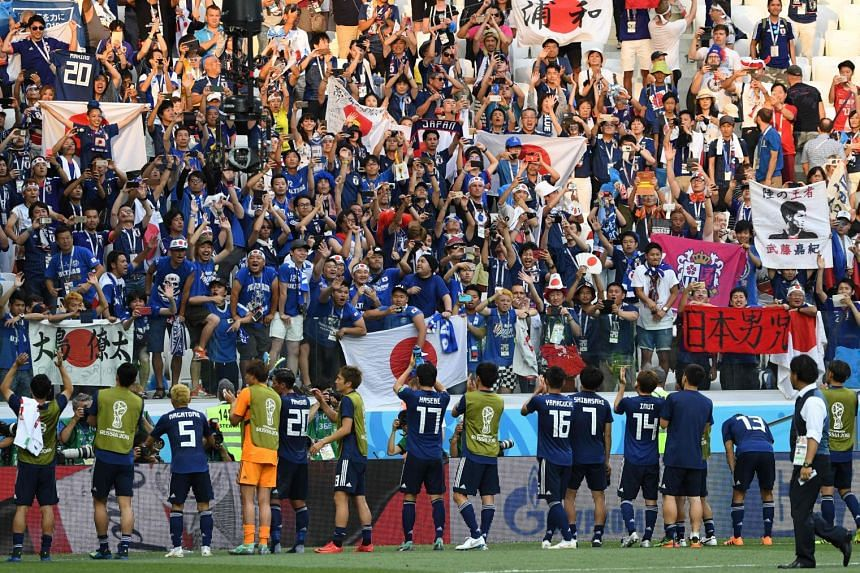Japan players celebrating their qualification for the round of 16 despite losing 1-0 to Poland in their Fifa World Cup Group H match at the Volgograd Arena in Volgograd on June 28, 2018.