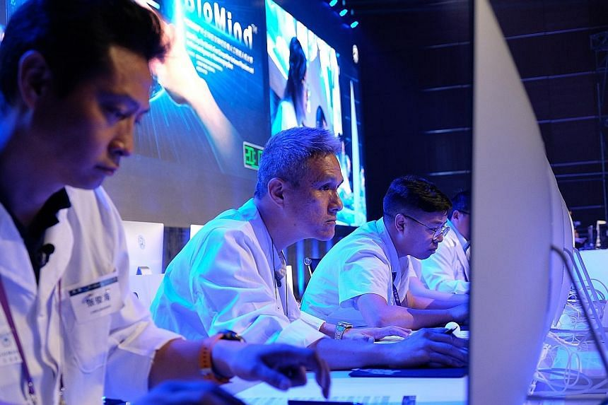 Professor Tchoyoson Lim (second from left) was part of a team of human doctors that took on - and lost to - AI doctor Biomind during a match at a neurology conference in Beijing yesterday.