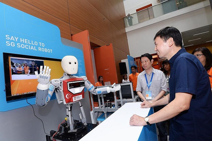 Senior Minister of State Chee Hong Tat viewing a demonstration by one of the exhibitors at the SkillsFuture Festival yesterday.
