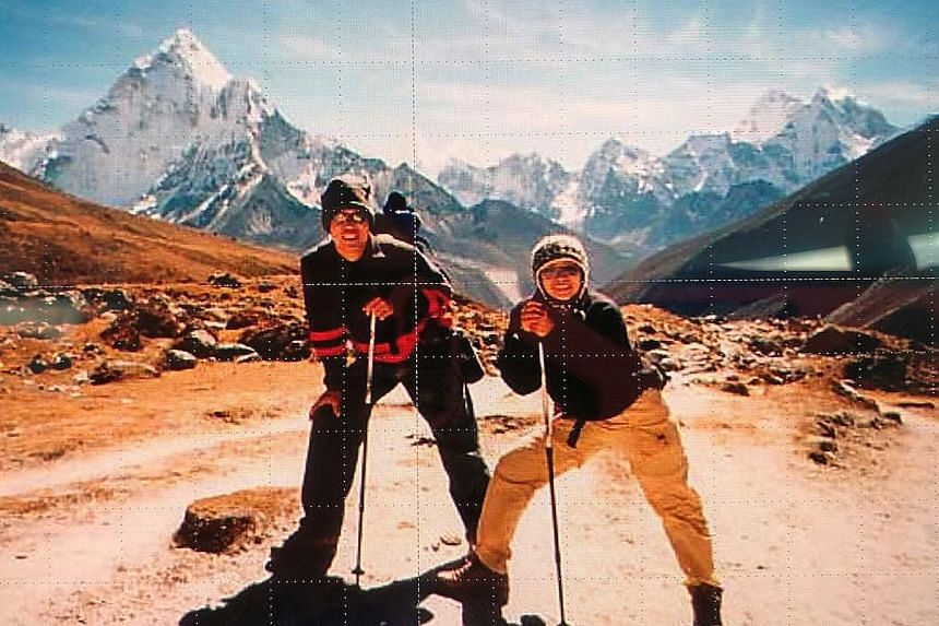 Madam Chui with her husband at the Everest base camp in 2004, one year after she finished treatment for cancer. Madam Irene Chui has been captain of Breast Cancer Foundation-Paddlers In The Pink for three terms, leading the dragon boat team in many c
