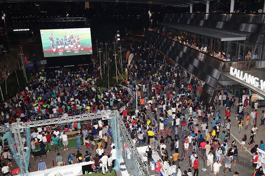 The crowd at the Singapore Sports Hub's Festival of Football last night who turned up to watch the live screening of the France v Argentina match at the OCBC Square outside Kallang Wave Mall.