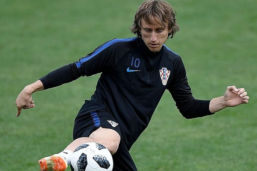 Luka Modric in a training session at the Roschino Arena, outside St Petersburg, on Friday. The Croatia captain led his team to the top of their group and hopes to fulfil a dream that began when he watched his nation record its best World Cup showing