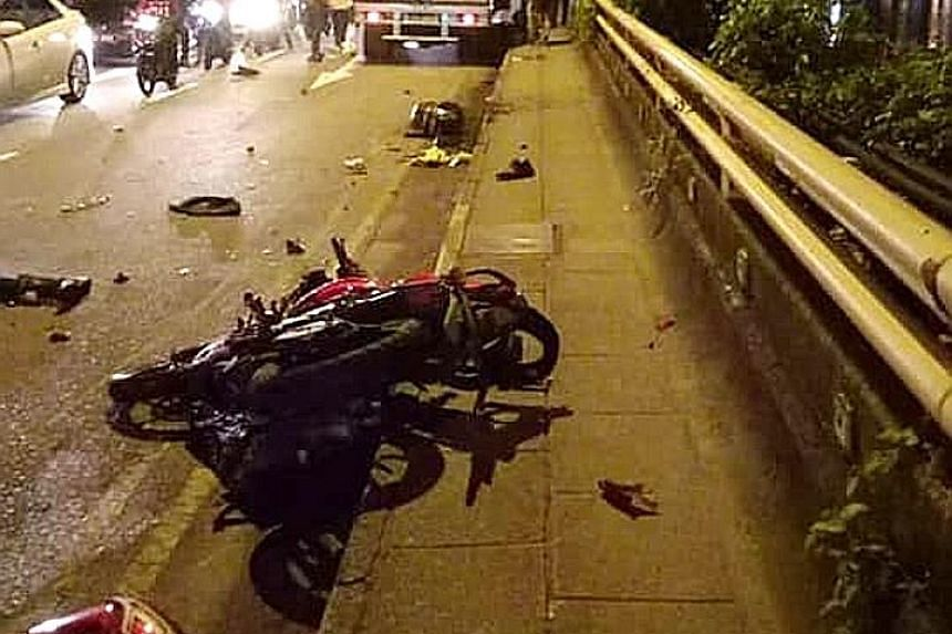 Photos of yesterday morning's accident posted on social media showed motorcycles strewn along the road and one underneath a lorry (top right).