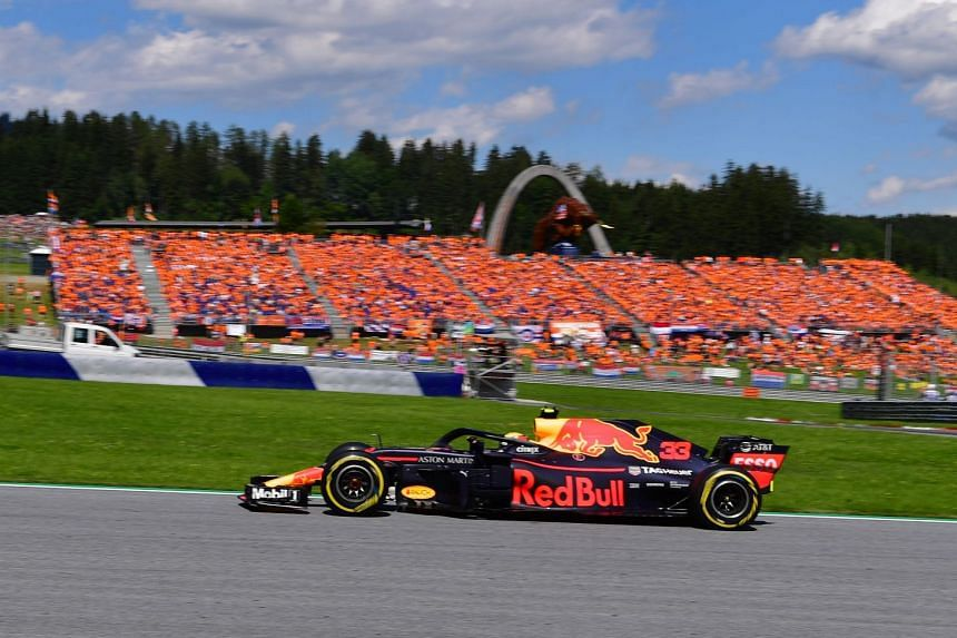 Red Bull's Dutch driver Max Verstappen steering his car to victory in the Austrian Formula One Grand Prix in Spielberg on July 1, 2018. It was his fourth race win.