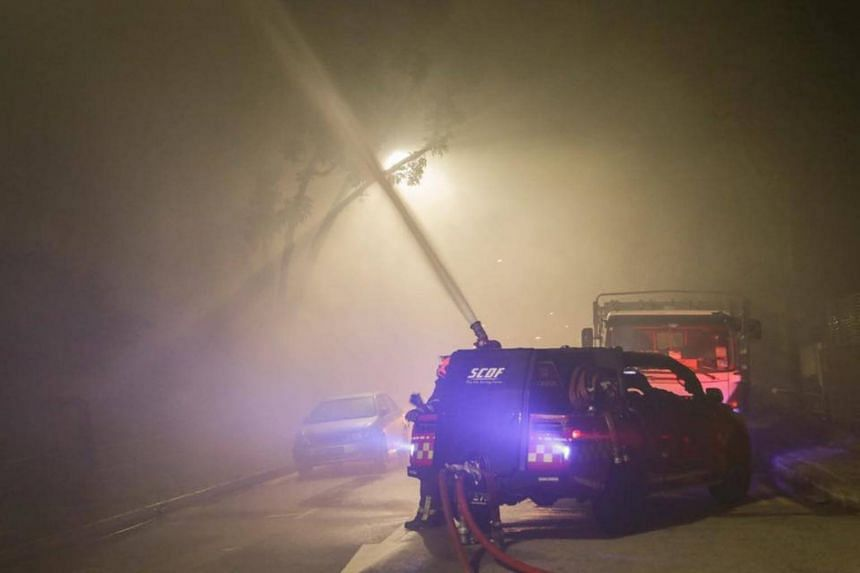 Firefighters took some four hours to put out an early morning blaze at a Defu Lane industrial building, on July 1, 2018.