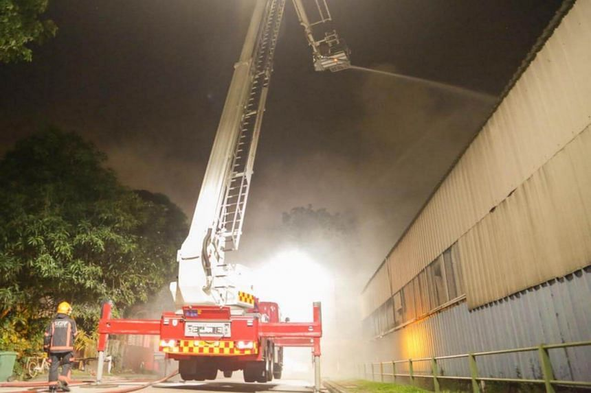 The Singapore Civil Defence Force said the fire involved general waste products in a storage area measuring roughly the size of a basketball court.