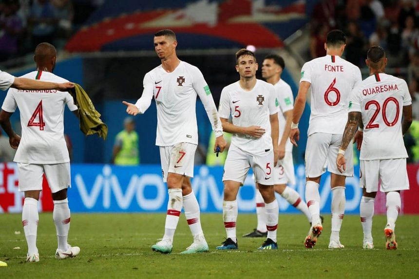 Portugal's players  look dejected after losing their match against Uruguay during the Fifa World Cup 2018 at the Fisht Stadium in Sochi, on June 30, 2018.