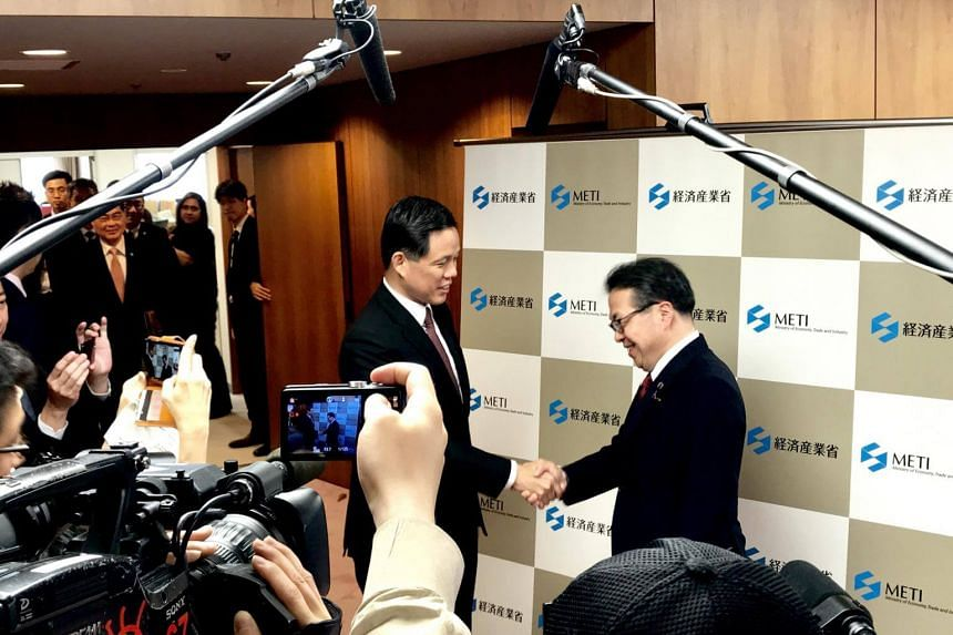 Trade and Industry Minister Chan Chun Sing (left) and Japan's Minister of Economy, Trade and Industry Hiroshige Seko shake hands before a bilateral meeting in Tokyo, on June 30, 2018.
