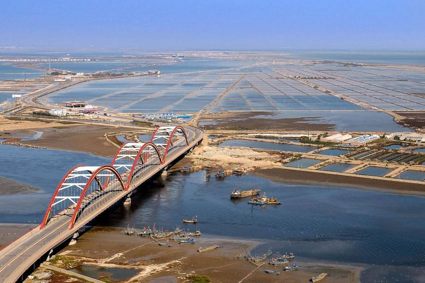 The approach to Tianjin Eco-city from the Rainbow Bridge in the Tianjin Binhai New Area, photographed in 2008. Tianjin Eco-city is Singapore's second government-to-government project with China after Suzhou Industrial Park.