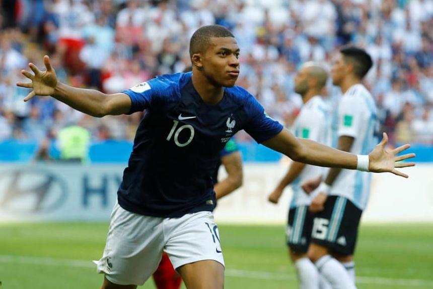 France's Kylian Mbappe celebrates scoring their third goal.