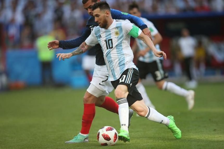 Argentina's forward Lionel Messi runs with the ball during the Russia 2018 World Cup round of 16 football match between France and Argentina at the Kazan Arena in Kazan on June 30, 2018.