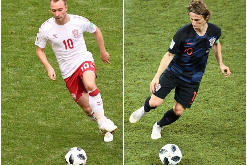 The match could end up being decided by two opposing midfielders, Luka Modric (right), one of the players of the tournament so far, and Denmark's highly rated Christian Eriksen.