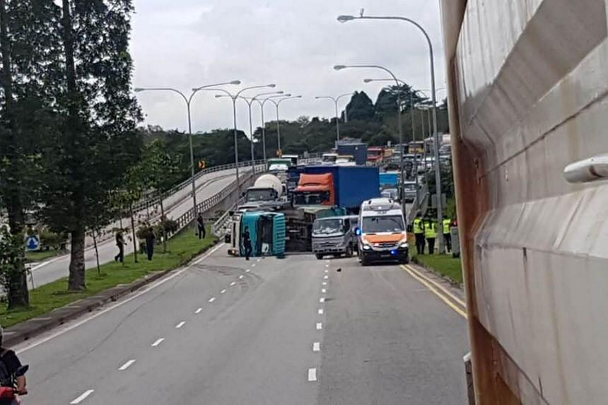 A tipper truck that skidded and flipped on its side caused a traffic jam along Turf Club Avenue on June 30, 2018.