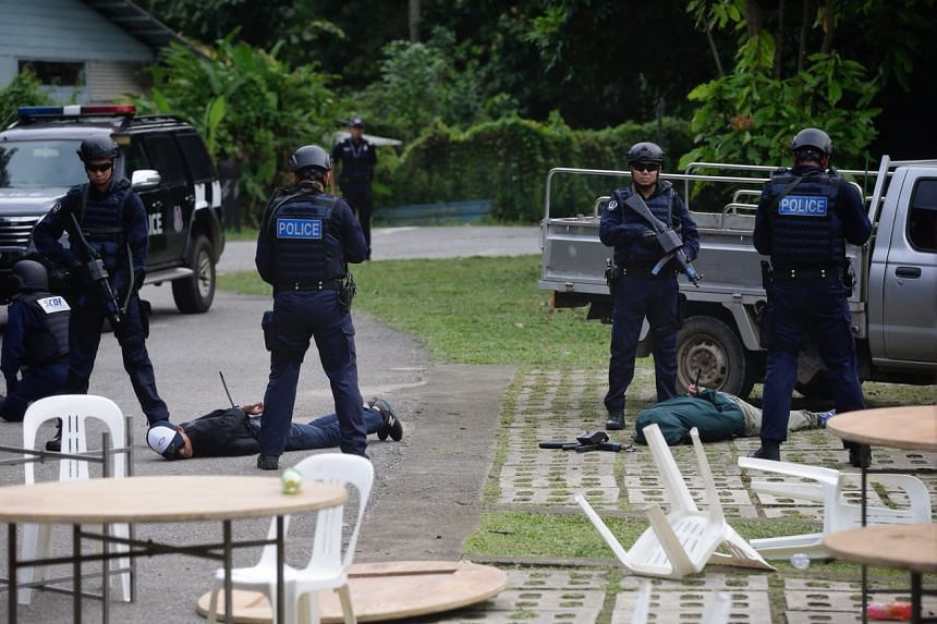 "Police apprehending ""terrorists"" during a counter-terrorism exercise held jointly by SPF, SCDF and Pulau Ubin Safety and Security Team for the first time on Pulau Ubin on July 1, 2018."