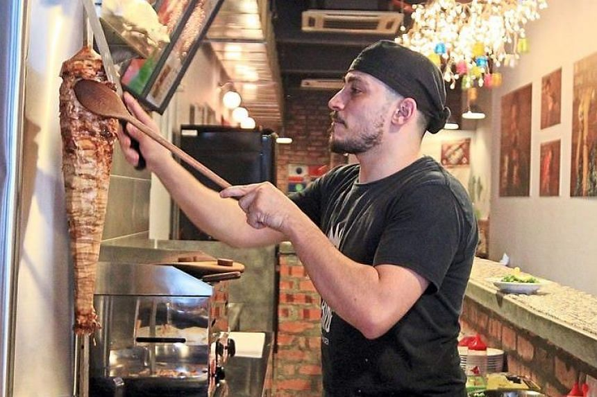 At Shawarma King, the kitchen is manned by Syrian chef Abd al Rahman al Khayat, who has nearly a decade of experience. You are likely to see him near the entrance of the restaurant, shaving off pieces of meat from the shawarma towers he has carefully