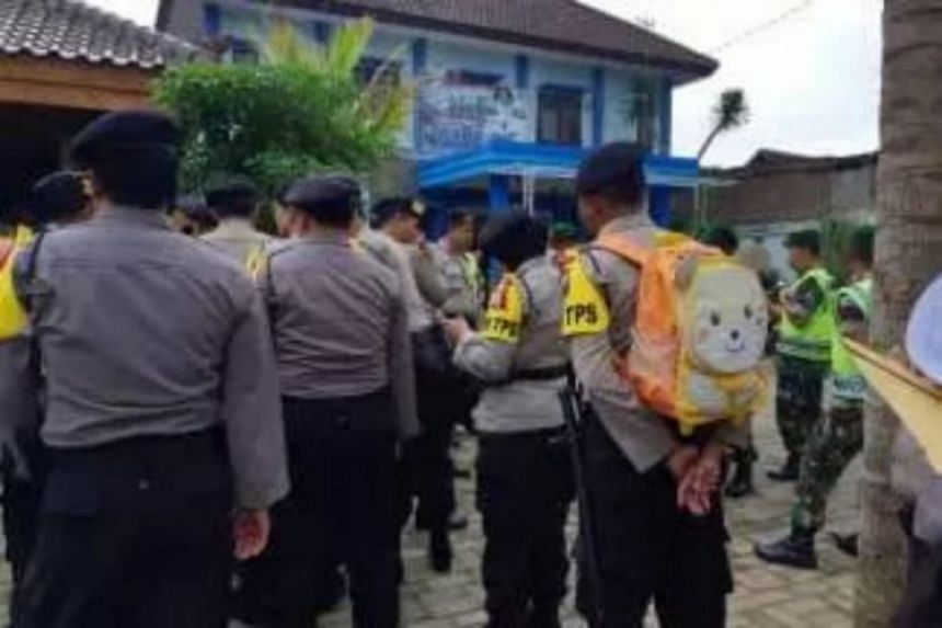 Police officer Dharma Budi Kusuma carrying the cute backpack during a security briefing in Malang, Indonesia, on June 26, 2018.