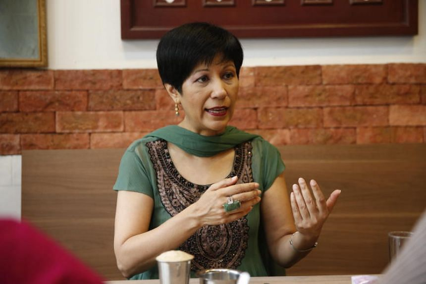 """Minister in the Prime Minister's Office Indranee Rajah has refuted an online post that claimed she """"hurried away"""" from a couple during her monthly walkabout at Tiong Bahru market."""