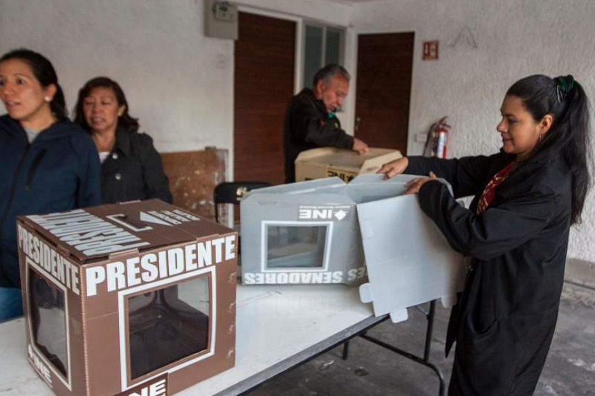 Election staff members preparing ballot boxes ahead of the opening of polls in Mexico City on July 1, 2018.