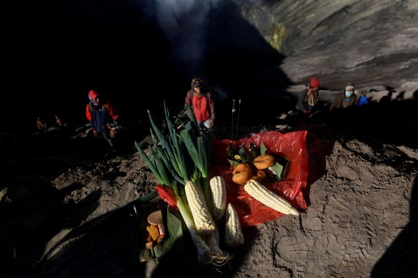 An offering placed at the crater of Mount Bromo during the Kasada ceremony, when villagers and worshippers throw offerings, livestock and other crops into the volcano.