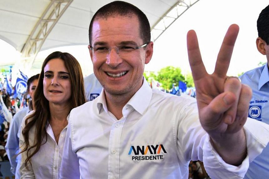 Mexican presidential candidate Ricardo Anaya flashing the V sign at a campaign rally in Leon, Guanajuato state, on June 27, 2018.