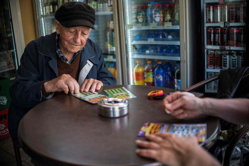 An elderly man buying scratchcards at a coffee shop in the village of Tsurkva, near Sofia, on May 28, 2018.