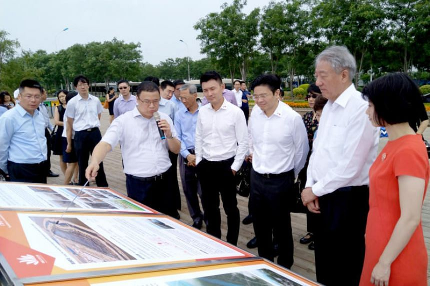 """DPM Teo Chee Hean (second from right), together with (from left) Ms Sun Xueling, Minister Lawrence Wong and Mr Baey Yam Keng touring a """"sponge city"""" in the Sino-Singapore Tianjin Eco-city on July 1, 2018."""