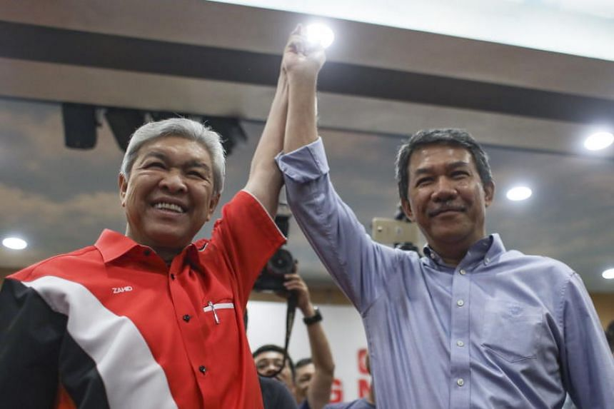 Newly elected Umno leader Ahmad Zahid Hamidi (left) and his deputy Mohamad Hasan celebrating after their victory, during a press conference on July 1, 2018.