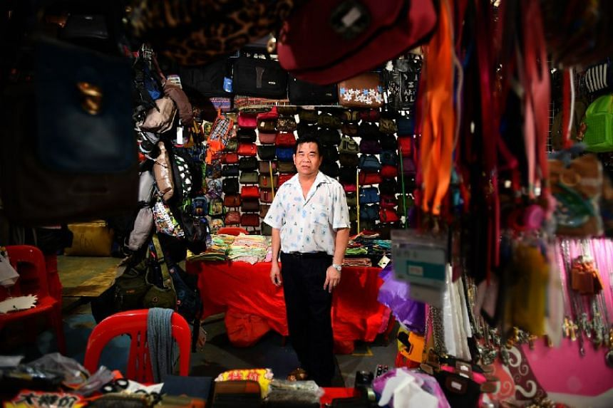 Mr Lim Dunxing, 55, a stall owner selling bags at the pasar malam between OG Albert Complex and Fu Lu Shou Complex, opposite Rochor Centre, on June 29, 2018.