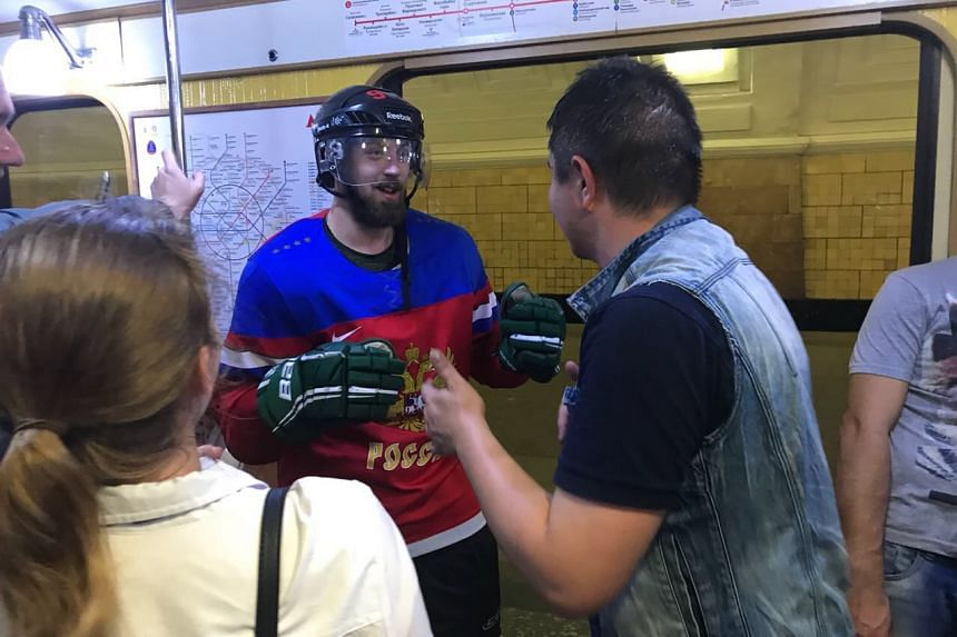A fan on a train about to exchange a friendly headbutt with another Russian who had appeared from nowhere in ice hockey gear, much to the amusement of other mobile-phone wielding passengers.