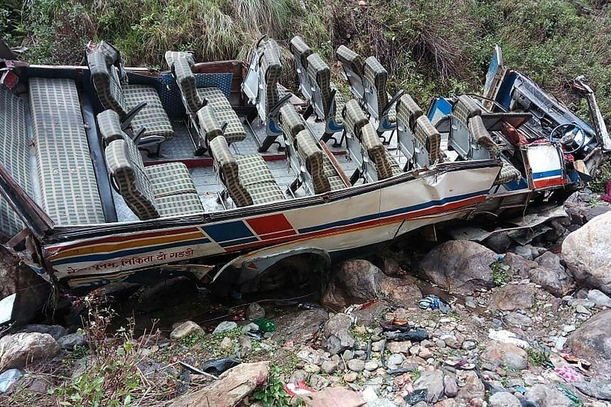 The twisted chassis of a passenger bus with the roof sheared clean off after it crashed into a gorge in northern India yesterday. At least 44 people were killed and three others injured, officials said. Search and rescue crews were at the crash site