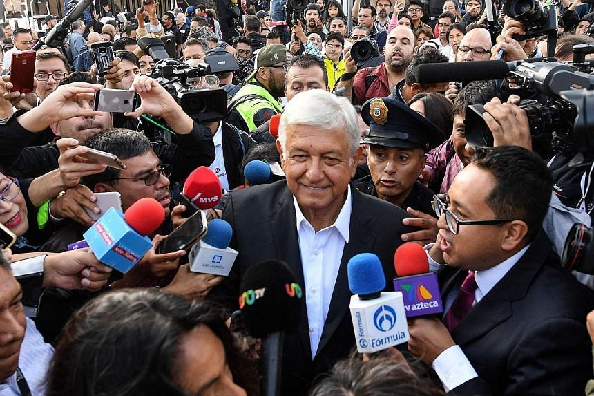 Presidential candidate Andres Manuel Lopez Obrador surrounded by a crowd at a polling station in Mexico City yesterday.
