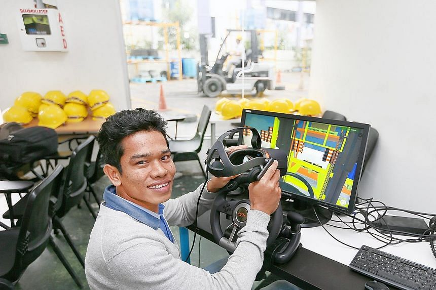 Stock taker Htet Win getting extra practice handling a forklift with the help of virtual reality.