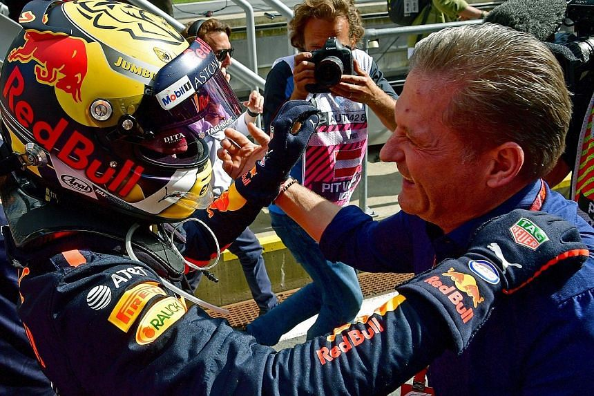 Max Verstappen hugs his father Jos, a former Formula One driver, after his victory in the Austrian Grand Prix yesterday. It was the Dutch driver's first win this year.