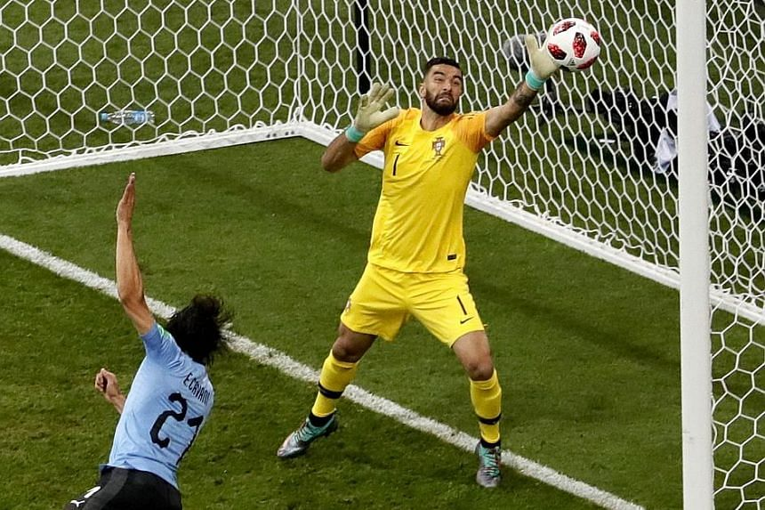 Left: Portugal's Cristiano Ronaldo is marked tightly by Uruguay midfielders Lucas Torreira (second from left) and Nahitan Nandez in Sochi on Saturday. Below: Edinson Cavani opening the scoring for Uruguay. He also netted the winner after Pepe's equal