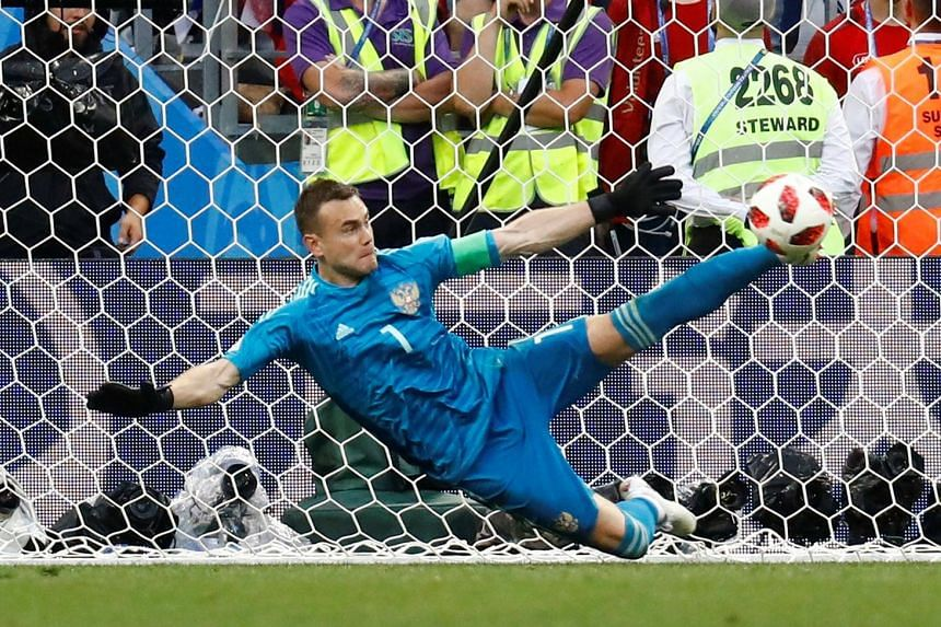 Russia goalkeeper Igor Akinfeev sticking out his foot to save a spot kick from Spain substitute Iago Aspas during the penalty shoot-out. It was his second save from Spain's five kicks, putting the hosts through 4-3 on penalties.