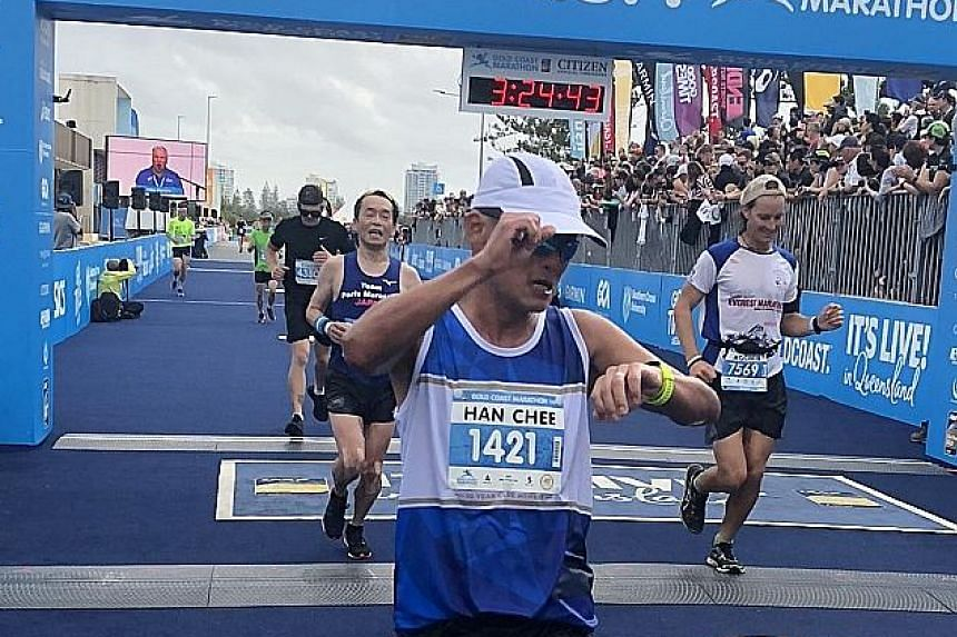 Singaporean Lim Han Chee crossing the Gold Coast Marathon finish line yesterday. It was his 10th time at this race, where more than 450 Singaporeans, including Shirlene Poon (above) took part.